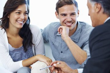 Couple discussing interest rates with Mortgage Broker