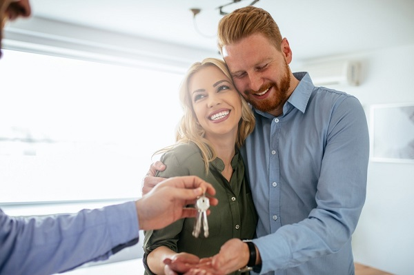 A happy couple who just bought a home